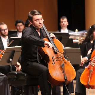Bachelor of Music students perform string instruments in concert.
