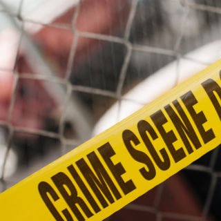 Examining a crime scene in the online criminal justice degree program.