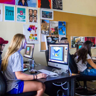 Students taking graphic design classes on Lynn campus.