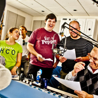 Communication majors learn how to write scripts at a radio station.