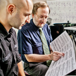 Conservatory student plays piano with composition faculty.