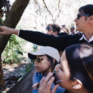 Dr. Watson, professor of environmental studies, takes students to a nature preserve.