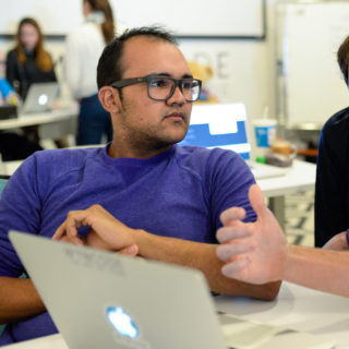 Students learn web design in the Wyncode Academy program.