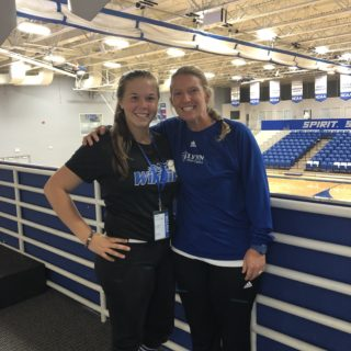 Bailey Fernandez, future student, visits with Coach Moore.