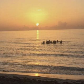 Friends enjoying sunrise at Palmetto Park Beach in Boca Raton