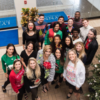 The Office of Marketing and Communication at Lynn University celebrate the holidays with costumes, a pot-luck lunch and games.