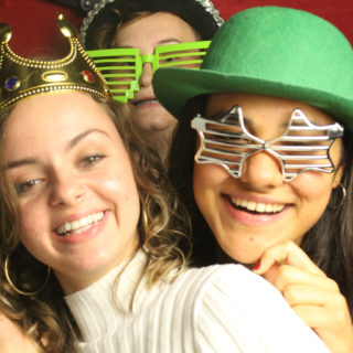 Students use props in the Library's photo booth