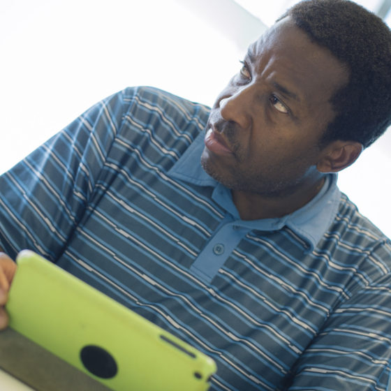 Jerome Vickers works on the Ed.D ebook at Lynn.